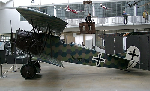 First World War German Fokker DVII biplane using camouflage pattern.
